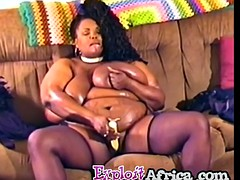 bbw ebony babe with hallowed melons is shoving a huge dildo into her