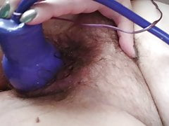 Expanding dildo stretches hairy pussy