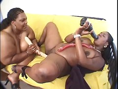 BBW ebony MILF fucks another BBW here a dildo at domicile