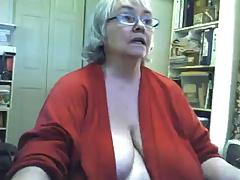 Fat saggy granny strips and masturbates on webcam