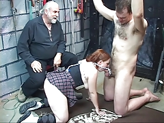 Young redhead blindfolds her victim and sucks on his little dick in basement